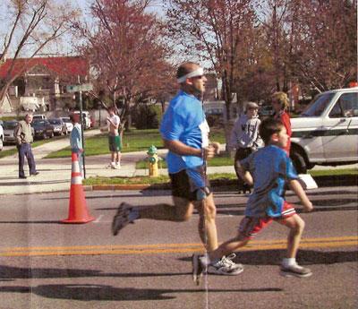 Larry Herman & Sam running the Garretti's 5K in Fredrick, MD 2004