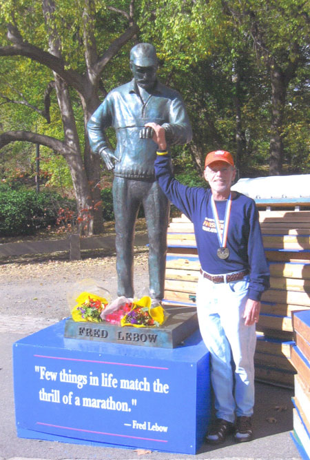 Peter Pressman with Fred Lebow statue in Central Park following the New York City Marathon in 2004.