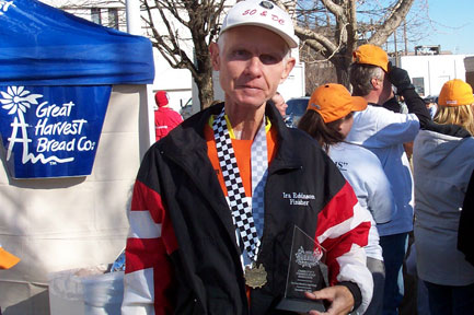 Ira Robinson with his 1st place trophy after the Charlotte Marathon on 12/09/06