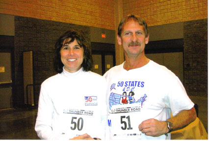 Help from Bart Yasso of Runner's World Magazine, Linda Thompson got her favorite number 50 and Jerry Schaver got his favorite number 51 for the Charlotte Marathon on 12/09/06