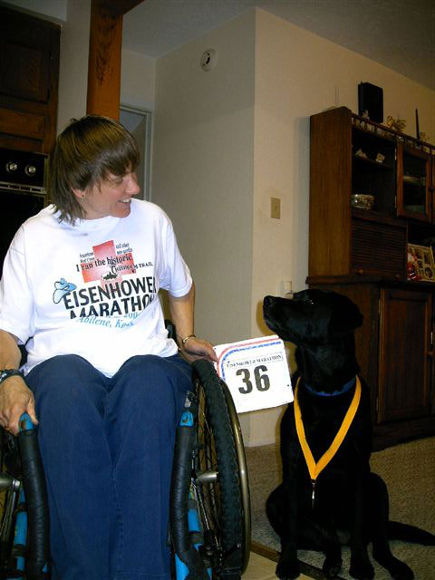Holly Koester and her service dog after the Eisenhower Marathon.