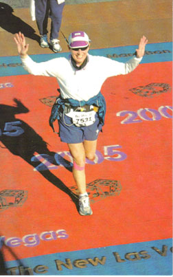 Harriet Ottaviano finishing the New Las Vegas Marathon in 2005 with a time of 5:59.