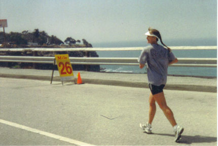 Kim Holliday running her 1st Marathon in Palos Verdes, CA in 2000. Photo taken by her Husband Grant. Grant and her grilfriend meet her at the 18 mile mark and give her support to the finish.
