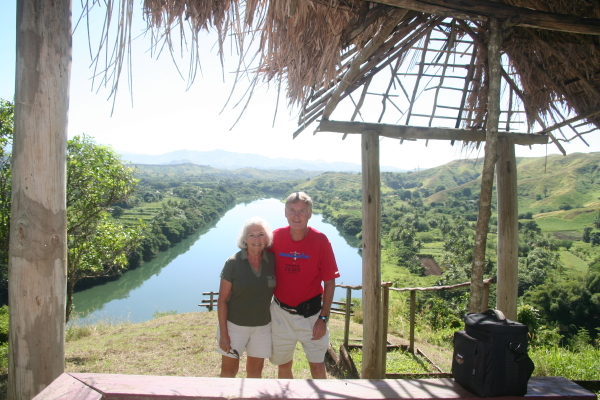 Maddog and his wife with a beautiful view of Sigatoka Valley Fiji.