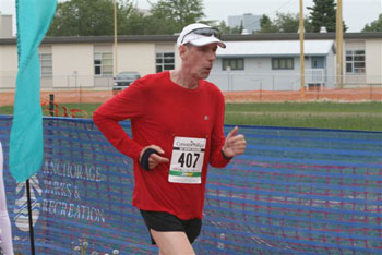 Jim Simpson finishing the Mayor's Midnight Sun Marathon on 06/23/07.