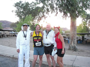 Runnin with the Devil, Lake Meade, NV before the start. Also same marathon at the finish with two other runners (Joyce, far right, was the races director)