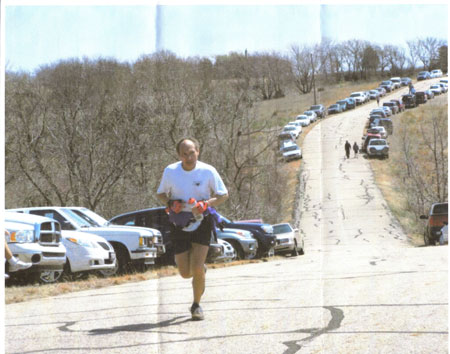 Bill Smith running up hill at one of his marathons.