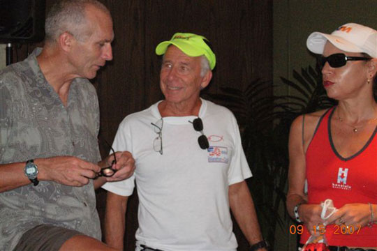 Rick Karampatsos with an other runner talk with Bart Yasso at a expo.