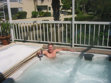 Maddog enjoying a much-needed (but not deserved) soak in the hot tub at home so he can walk at the party.
