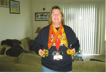 Peggy McKean with her metals after the Goofy's Challenge in Disney on 01/13/08.