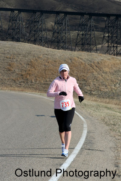 Michelle Fortenberry at the ING Trestle Valley Marathon in Minot North Dakota on 5/28/08, on a very blustery Road Kill Hill at mile 9. Michelle finished the half marathon with a time of 1:53:09 and finished 1st in the 35-39 age division and 9th female ove