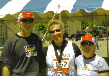 Meta Minton with race directors Eric and Dawn Easton at the finish of the Casper Wyoming Marathon 06/08/08.