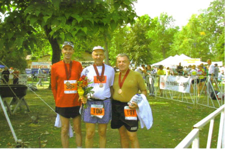 Al Kohli the Marathon Man after finishing his 100th Marathon at the Fox Cities Marathon on 09/21/08 with Jim Simpson, Al Kohli, and Henry Rueden.