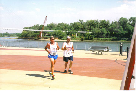 Jim and Kevin Patton going to the finish of the Omaha Marathon on 09/28/08. This was Jim's 50 & DC finish. Great Job!!!!!!!!!