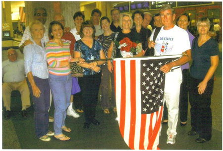Jim and Kathleen Patton at the Tampa Airport with running friends from there running group. Jim finishing the Omaha Marathon and finishing the 50&DC marathon circuit.