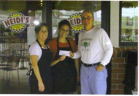 Owner of Heidi's Brooklyn Deli Left to right, Michele Tribou , manager Beckie Davis and Mike Brooks. Getting a check for Champ Sunshine for Mike?s goal of $10,000.