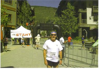 John Wallace as Maddog at the finish of the US Half Marathon at Copper Mountain,CO.
