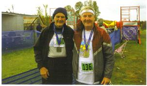 Wally Herman and Maddog at the finish line at the Ottawa Marathon. Together they represent a total of 1036 marathons and 199 countries!