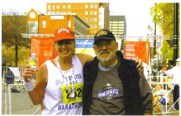 Meta Minton at the finish with David Towns. Meta completed the New Hampshire Marathon in Manchester,NH. This is Meta 48th State.