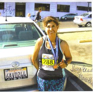 Jeannette Roostai finish the Long Beach Marathon in Long Beach, CA. This was Jeannette 86th marathon. 10/11/09.