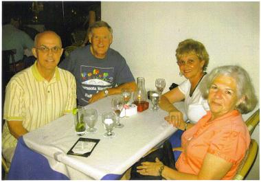 The Wallaces and Treiges enjoying a pasta dinner in South Beach.