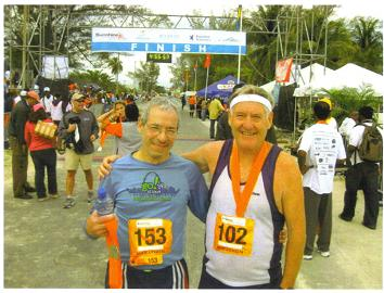 John Wallace as Maddog and Edson Sanches at the finish line in the Bahamas Marathon 2010.