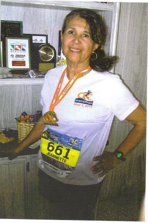 Jeannette Roostai after the O. C. Marathon at Newport Beach, CA. This is marathon #89 for Jeannette. 2010