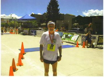 Exhausted Maddog putting on a good game face at the finish line of the Steamboat Marathon 05/21/10.