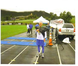 A wet and cold Maddog - still wearing a garbage bag at the finish line.