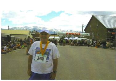 An exhausted - but glad to be finished - Maddog at the finish line of the Leadville Trail Marathon.