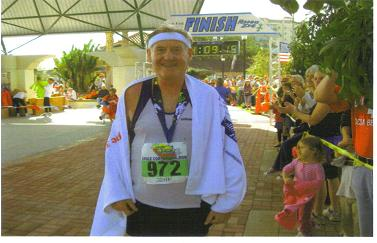A tired but HAPPY Maddog at the finish line in Cocoa Village.