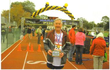 Maddog proudly displaying his 1st Place award at the finish line (not easy to win in this race!)
