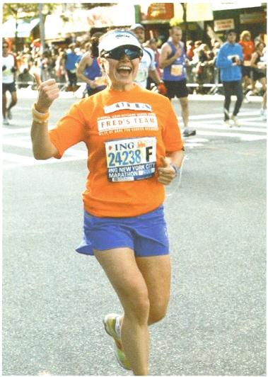 Julia Khvasechko running the New York City Marathon and Having a great time.
