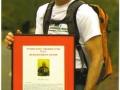 Richard Holmes holding his Humanitarian Award for 2010.