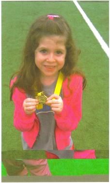 Bob Livitz granddaughter, Rachel with her medal for finishing Marathon Kids
