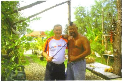 Maddog receiving a machete lesson from John - a local Chamorro.
