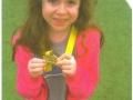Bob Livitz granddaughter, Rachel with her medal for finishing Marathon Kids