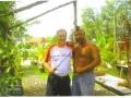 Maddog receiving a machete lesson from John - a local Chamorro.