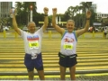 Maddog and Edson celebrating their finish of the Manila Marathon. Note MDs race #