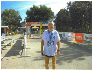 Maddog at the finish of the Ocala Marathon in Ocala, FL on 01/22/12. Marathon #352.