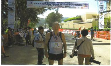 Maddog did not escape the heat (79 F & 80 % humidity at the 4:30 am start in the dark). it was brutal and he struggled to finish the Saipan Marathon in Saipan, Northern Mariana Islands in 5:03:02. Marathon #355 & Country # 113 ( note race bib). He also ac