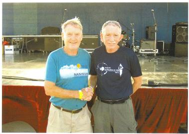 Photo of Maddog (l) and fellow Country Club member Brent Weigner (r) enjoying the awards ceremony after the Saipan Marathon.