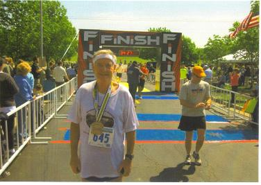 A photo of a 'happy' Maddog at the finish line in Olathe, KS.