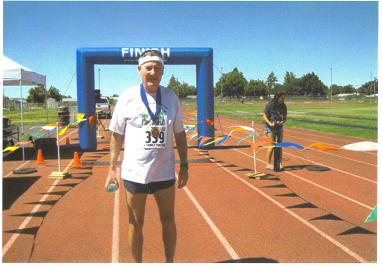 Maddog at the finish line Moses Lake Marathon.