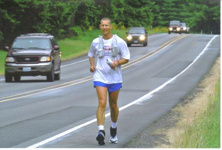 June 2, 2012 Mike Samuelson on Day 4 of the run across America on trail running north on HWY.507 just to the east of the Fort Lewis Military Reservation.