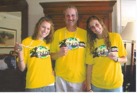 Emily Jones, Terry Jones, and Ashley Jones after the Honolulu Marathon. Terry?s two of his frequent and favorite running partners.