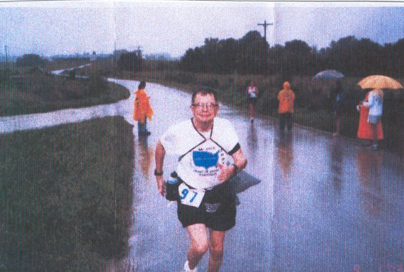John N. Strand finishes his 50th state on a wet and hilly course in Columbia, Missouri on September 1st, 2003.